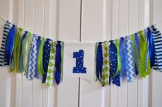 Fabric ONE highchair rag banner, Boys blue & green first birthday high chair banner, cake smash photo prop, highchair rag garland by GiddyGumdrops on Etsy https://www.etsy.com/listing/207864596/fabric-one-highchair-rag-banner-boys