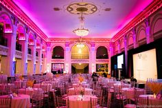 LED uplighting on the drape stage backdrop, black draping for stage backdrop, amber stage wash, gobo projections, lucite podiums, PA system, and projectors & screens for a corporate awards ceremony at the Ballroom at the Ben in Philadelphia. Photo by David Michael Howarth. Lighting, draping, and audio/visual production by Synergetic Sound + Lighting: www.synergeticsounds.com