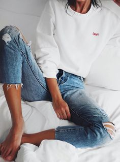 jeans and a sweatshirt