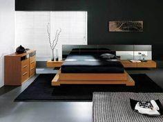 black bedroom with brown furniture