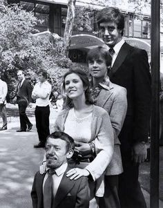 Kenny Baker ( R2-D2 ), Carrie Fisher ( Princess Leia ), Mark Hamill ( Luke Skywalker ), Peter Mahew ( Chewbacca ) in a Star Wars behind the scene photo.