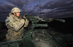 Royal Canadian Dragoons, Bravo Squadron, Corporal Judd Walsh mans the front gate of Patrol Base Marianne using a 50 caliber machine gun attached to a Light Armoured Vehicle (LAV). Military Deployment, Military Police, Military Weapons, Military Uniforms, Royal Canadian Navy, Canadian Army, Force Pictures, Afghanistan War, Us Coast Guard