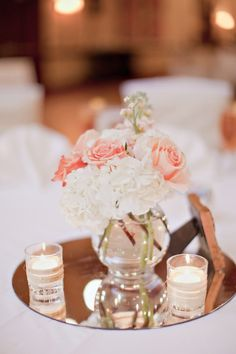 Blush Wedding- like the idea of a mirror underneath centerpiece flowers