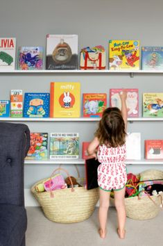 Wonderful Book Shelves - Children's Books are Bright and Beautiful on a Wall! Great for Framed Art from Your Little Leonardos & Family Photos, too!   via homelife.com