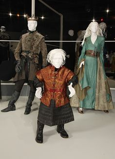 Game of Thrones: Nominated for 2012 Emmy for Outstanding Costume Design: Costume Designer, Michele Clapton, Assistant Costume Designer, Alexander Fordham and Assistant Costume Designer, Chloe Aubry. (L to R) Gethin Anthony as Renly Baratheon, Peter Dinklage as Tyrion Lannister, Lena Headey as Cersei Lannister. larp