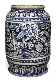 A LONDON DELFT BLUE AND WHITE APOTHECARY JAR  1600 - 1640 probably Aldgate or Southwark Of cylindrical form, painted with a broad band of continuous scrolling foliage within gadrooned and dot-pattern borders