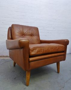 1960s tan leather armchair by Skipper Furniture, Denmark www.archivefurniture.co.uk