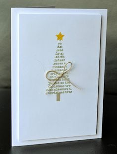 handmade Christmas card from A Little Space of My Own ... clean and simple ... triangle tree of upcycled paper .. gold star ... gold twine bow ... like the finished look created by putting the card face on a raised panel with large margin ...