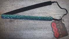 Skinny Aqua Sparkle  Cool blue sparkles fade from royal to aqua brightening any look.  Price: $9.99