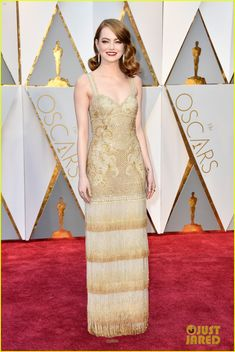 Old Hollywood Glamour: Emma Stone shined brightly like a star on the silver screen  in a gold and bronze Swarovski crystals embroidered Givenchy gown, with cream-to-bronze dégradé crystal fringes at the 2017 Oscars