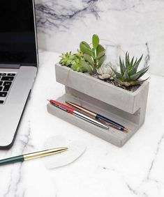 Concrete Desktop Planter by Kikkerland Design! Head to for more amazing projects!