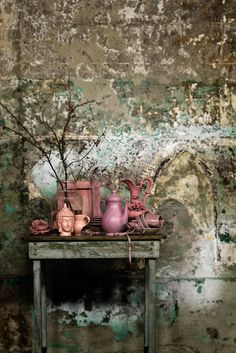 Jeroen van der Spek photographer via Stills | stillstars.com. old patina gold / turquoise grey stucco walls & pink still life