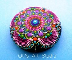 Mandala Hand Painted Stone This precious stone was created with much love and joy. The mandala stones have in them many hours of joyful work and prayer for the owner to feel the vibration of joy, happiness and worth of our beautiful Universe. Size: 6cm diameter = 2 1/2inch. I use a