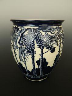 Pines and pinecone vase.