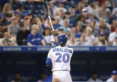 Josh Donaldson Photos - Josh Donaldson #20 of the Toronto Blue Jays tosses his bat away after he was called out on strikes to end the eighth inning during MLB game action against the Detroit Tigers on July 8, 2016 at Rogers Centre in Toronto, Ontario, Canada. - Detroit Tigers v Toronto Blue Jays