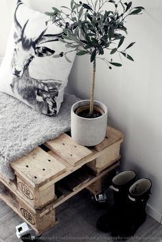 two crates stacked with thick blanket for seating