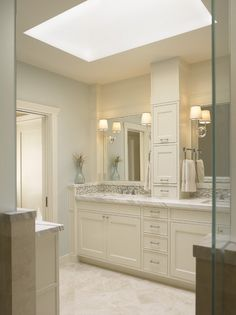 carrera white marble top with some beautiful cabinetry.  i like the raised edge that has the integrated back splash.