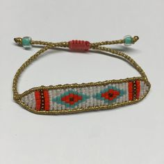 Gold, white and orange band macrame bracelet