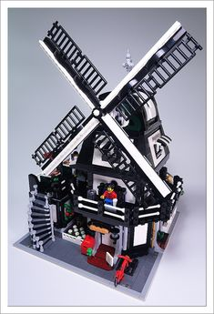 "Korion ""converted"" an old windmill to a sleek bakery and cafe. The 2998 piece modular model 10 Minifigs (and 3 animals) and an outdoor terrace on the second floor."