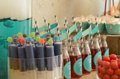 Treat ideas for a fun and wacky science party.  Syringes filled with coloured condense milk capped with jelly tots.  Bottle labels, straw toppers and cupcake wrappers all provided by Chic My Party.