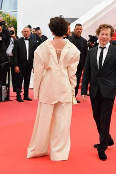 Jeanne Balibar and Mathieu Amalric attends the 'Loveless ' screening during the 70th annual Cannes Film Festival at Palais des Festivals on May 18...
