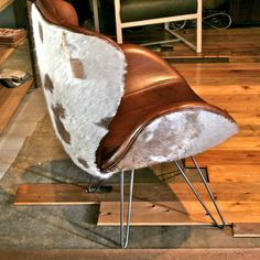The comfy Eames chair... (quoting Steely Dan)  Cowhide Leather Eames Chair. $1,075.00, via Etsy.