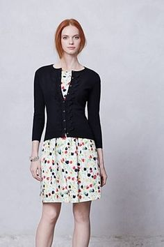 black cardi with scalloped frill and spotted white dress. Anthropologie