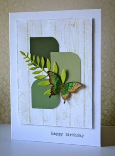 handmade card by By Ann Tuck ... montage of squares punched from paint sample cards ... die cut leaft and butterfly ...  like the design ...