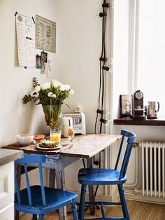 little birdie: blue chairs in kitchen