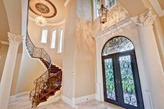 Inside this luxury home for sale are exquisite stone floors, iron rails, and a magnificent sweeping staircase. Also included are foyer and living room chandelier lifts.