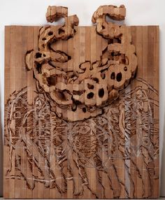 """Ursula von Rydingsvard.  wood as a """"backdrop"""" incorporating varying elements."""