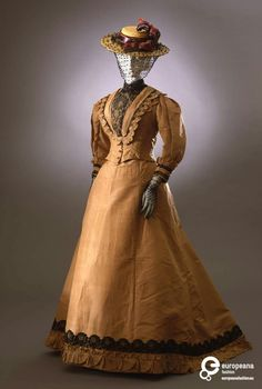 Ooh, I like this! c.1892-94 walking dress in tobacco-colored silk taffeta. Galleria del Costume di Palazzo Pitti.  But interesting because the bodice trim and sleeve cuff are very 1870s flavored and the sleeves could almost pass for about 1905-ish. The skirt is definitely 1890s cut.