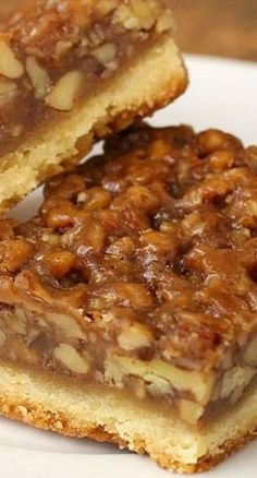 The Best Ever Pecan Pie Bars are so good people offer to pay me for them. A fabulous recipe with a caramelized pecan pie set atop a shortbread crust is the absolute perfect nut bar. My family requests more of this dessert than any other every year. 13 Desserts, Southern Desserts, Brownie Desserts, Delicious Desserts, Yummy Food, Southern Pecan Pie, Southern Christmas Recipes, Hawaiian Desserts, Fall Dessert Recipes