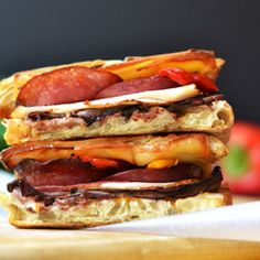 Smoked Gruyere Panini with roast beef, roasted chicken, salami and roasted peppers