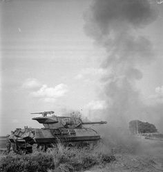 An Achilles tank destroyer of 75th Anti-Tank Regiment, Royal Artillery, 11th Armoured Division, fires its 17-pdr gun at pillboxes on the German frontier.