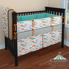 Crib bedding in Solid Cloud Gray, On The Go Retro, Solid Orange, Solid Emerald Turquoise. Created using the Nursery Designer® by Carousel Designs where you mix and match from hundreds of fabrics to create your own unique baby bedding. #carouseldesigns