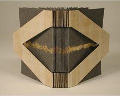 "Zakka II by James Reid-Cunningham. Textblock composed of bifolios of gray Hewits cover paper, decorated with gold leaf.  Sewn with black linen thread in a long stitch.  Punctured boards covered in papyrus.    4"" x 3"" x 1"". 10.2 x 7.6 x 2.4 cm.    Bound in 2003."
