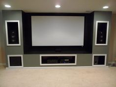 Built-in entertainment system in basement-projection screen instead of TV (projector is ceiling-mounted) Steven has my permission to do this in the basement. :D - House Interior Designs Movie Theater Rooms, Home Cinema Room, Home Theater Setup, Home Theater Design, Home Theater Seating, Movie Theater Basement, Dream Theater, Entertainment Room, Entertainment System