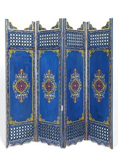 Moroccan painted-wood screen in Berber-blue by Moroccan Prestige; $1,150. moroccanprestige.com