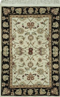 HANDMADE RECTANGULAR PERSIAN TABRIZ AREA RUG IN BEIGE WITH BLACK ACCENTS, 2X3 Handmade and knotted rectangular Persian Tabriz area rug with leaf and floral designs in beige with black accents, 2x3. Made with wool and silk. Free Shipping within the US.