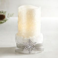 Our LED pillar comes elegantly dressed in a faux fur belt and sparkly ornament.