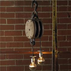 "Wendy Umanoff double pulley pendant. ""We had outlets on pulleys that hung from the ceiling at SU #warehouse, love the adjustability/interaction that just isn't the same as an arm in a floor lamp."""