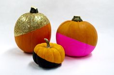 Sometimes carving pumpkins can be a serious chore. Though we appreciate the effort that goes into a well-carved pumpkin, we also love a good hack. Earlier this week we shared our striped and studded pumpkins, and now we've got another no-carve trick. Glitzy Color-Dipped Pumpkins!