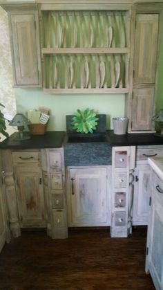 Custom mini kitchen from Springhouse Designs handmade soapstone sink and counters over reclaimed century old pine cabinets RUSTIC  LUX
