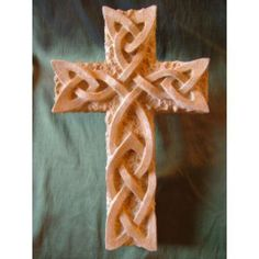 Reconstituted sandstone sculpture by artist David Buck titled: 'Celtic Knot Cross'