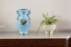 The dotted planter was handmade by Ingrid and pairs beautifully with this antique vase.