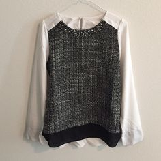 Tweed embellished blouse in chic black and white Super chic blouse with tweed-like front and jeweled embellishments. The back part is plain white with key hole closure. Very elegant! New without tag. Fits XS or S. Tops Blouses