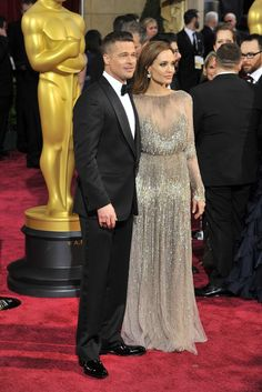 Brad Pitt in Tom Ford with Angelina Jolie in Elie Saab and Robert Procop. [Photo by Donato Sardella]