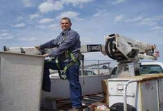 Bucket truck to make repairs by Gray Electric of Mauston and Tomah, WI