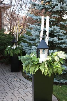 lanterns!  Add something different to your winter planters to make them stand out. Planter by: Elegant Surroundings By Diane www.elegantsurroundings.ca
